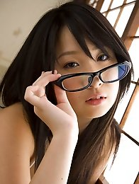 Plump asian school girl takes off her clothes and shows a bikini