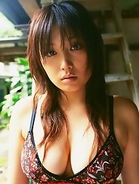 Sizzling hot asian beauty looks delicious in her red bikini