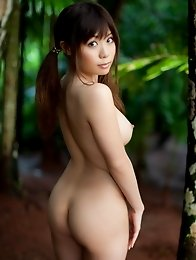 Honey busty and nude girl Aya Hirai posing naked in the woods