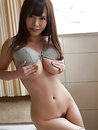 Sweet and horny Japanese av idol Mikuru Mio shows her hairy pussy and her busty tits