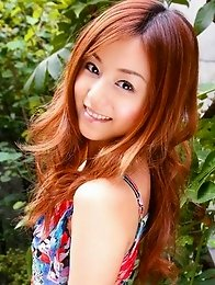 Red headed asian cutie posing in a floral printed dress