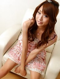 Adorable asian fox with long hair in a short pink dress